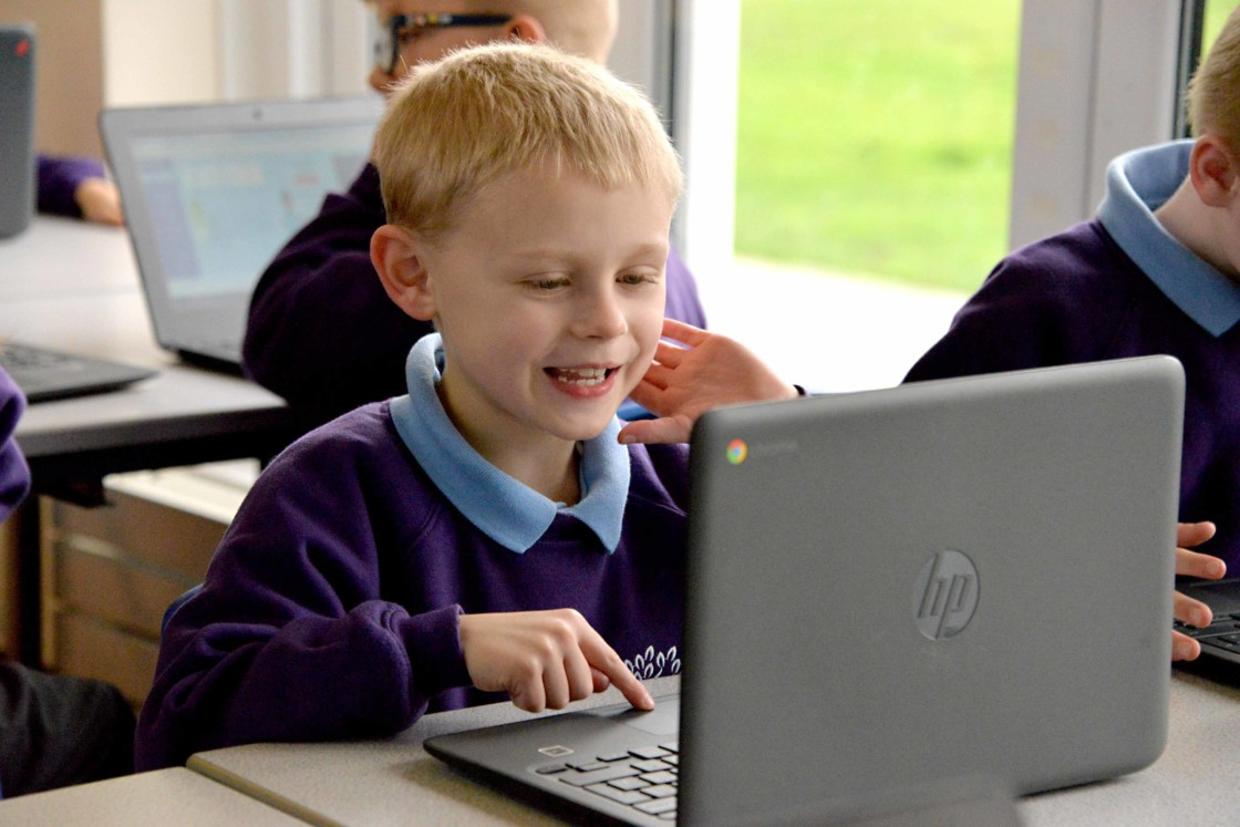 Pupil working on a laptop computer